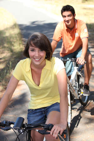 Teenagers out cycling together photo