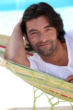 loosen up: Man at beach laid in hammock