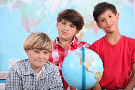 beautiful boys: Little boys in classroom Stock Photo