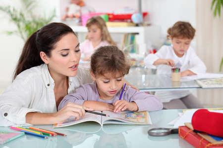 teaching crayons: Teacher with a pupil