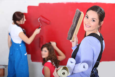 paintbucket: Woman painting wall