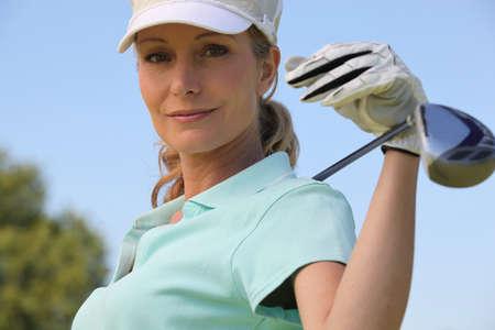 golf swing: Female golf player