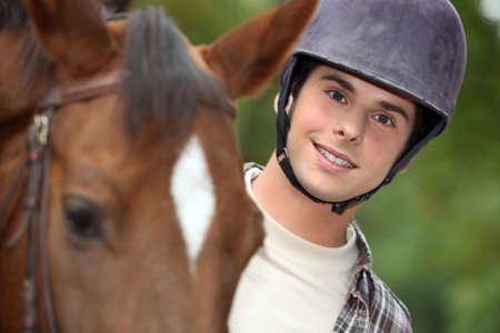 obstacle course: young man riding a horse Stock Photo