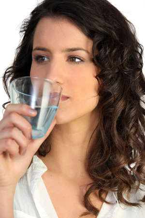 Woman drinking glass of water photo
