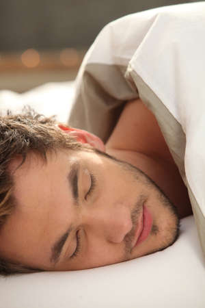 young man sleeping photo