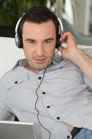 Man listening to headphones photo