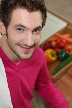 young man making salad Stock Photo - 12500088