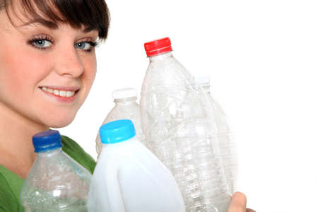 reprocess: Woman holding plastic bottles