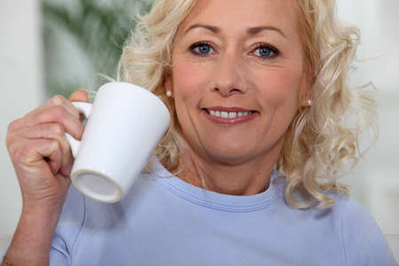 40s adult: I always enjoy a nice cup of coffee  Stock Photo