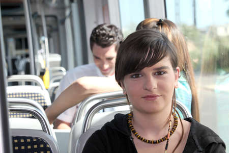 Teenager on the tram photo