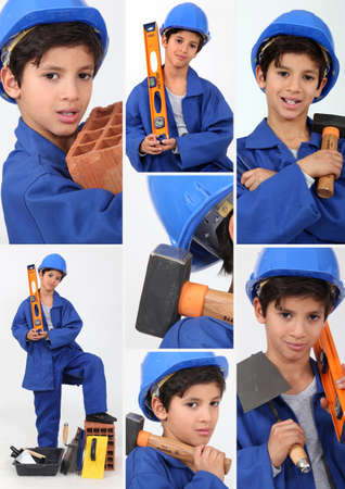 jumpsuite: a boy dressed in workman with tools Stock Photo