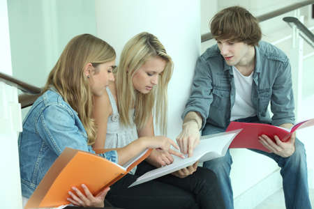 16 17: Teenagers sitting on steps Stock Photo