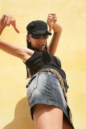 Attractive brunette in sunglasses striking a pose photo