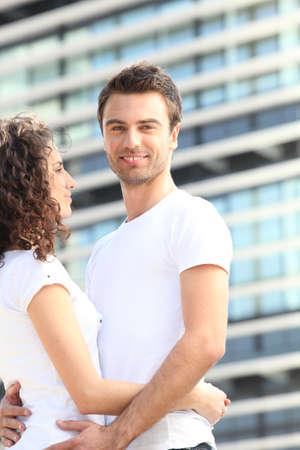 Young couple stood outside photo