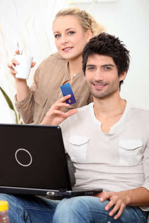Couple doing online shopping  Stock Photo - 12500359