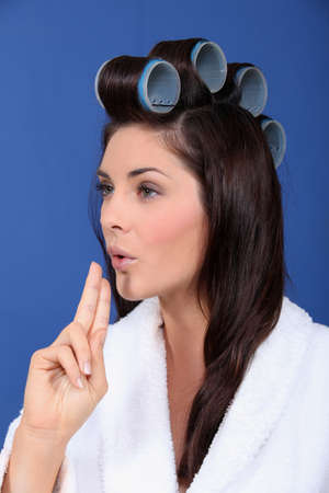 Woman with her hair in large Velcro rollers photo