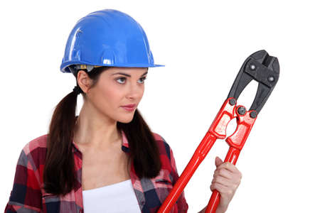 Brunette holding pair of bolt-cutters Stock Photo - 12479272
