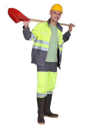 diggers: Man holding spade over shoulder