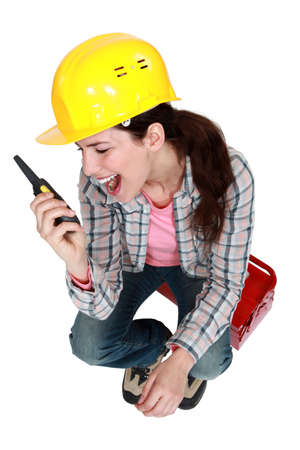 fluency: Woman sitting on toolbox with radio in hand