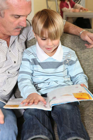 grandfather reading with his grandson photo