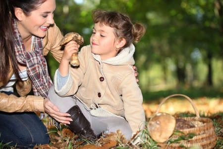 mummy and daughter in the woods photo