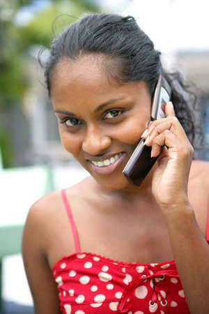 Happy woman speaking on the telephone photo