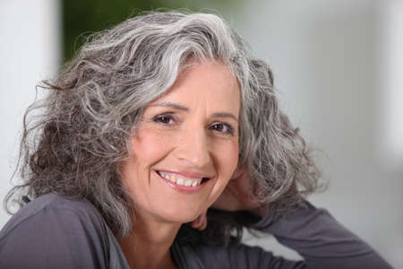 Close-up of grey haired woman at home Stock Photo