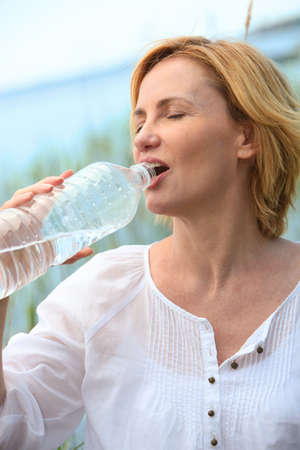 woman drinking water photo