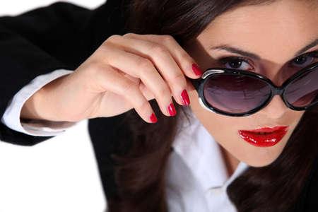Businesswoman wearing sunglasses photo