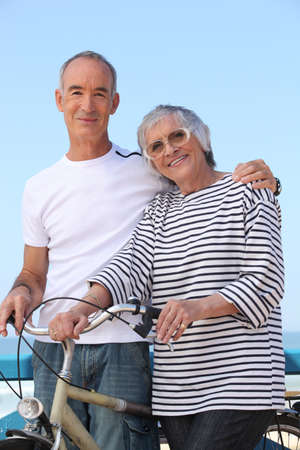 Elderly couple out for a bike ride Stock Photo - 12500540