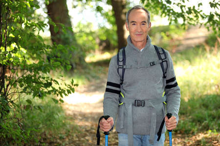 55 to 60: Elderly person hiking Stock Photo