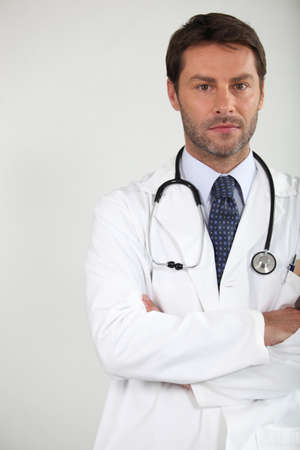 Male doctor stood arms folded with stethoscope around neck Stock Photo - 12499781