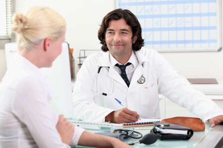 Doctor consulting with a patient Stock Photo - 12499680