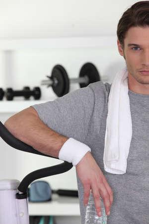 ego: Man taking a break at the gym