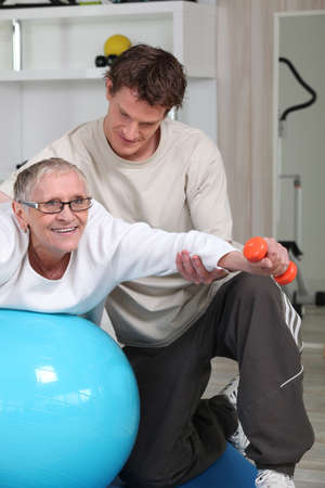 gaudy: physiotherapist and mature patient Stock Photo