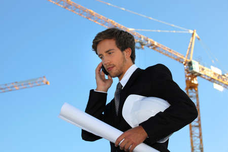 Young and handsome engineer working on-site photo