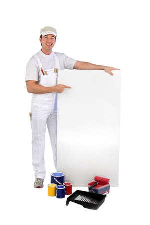 promoting: craftsman painter promoting his work Stock Photo