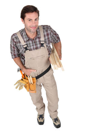 Builder wearing tool belt  photo