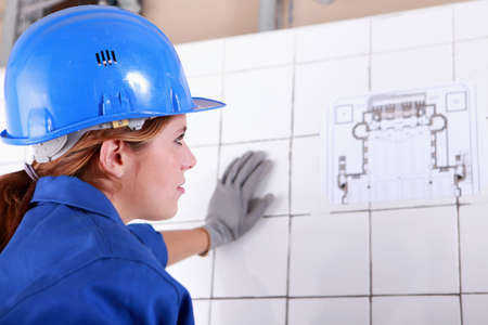 Woman foreman consulting plan photo