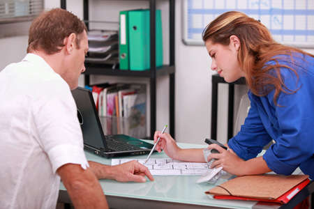 tradespeople: Tradespeople discussing a project