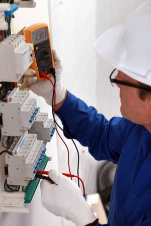 electrical panel: Man with a voltmeter in electrical panel Stock Photo