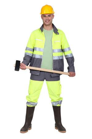 Tradesman holding a mallet Stock Photo - 12530078