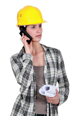 woman engineer: craftswoman talking on her cell phone