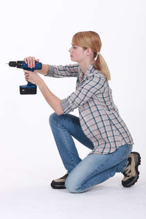 Female wall drilling Stock Photo - 12529684