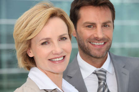 Businessman and woman smiling Stock Photo - 12529739