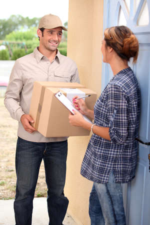 order shipment: Woman receiving shipment at home