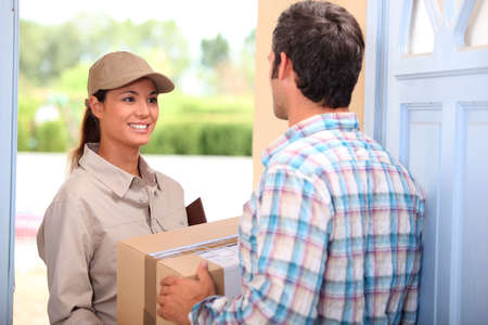 parcel service: Woman delivering parcel