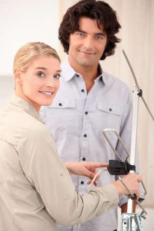 cable tv: Couple setting up an antenna Stock Photo