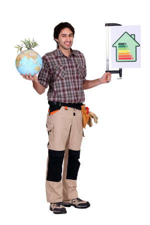 Man holding a globe and a sign for energy consumption photo
