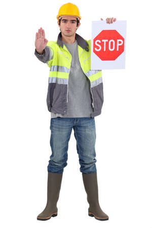 Traffic guard directing traffic photo